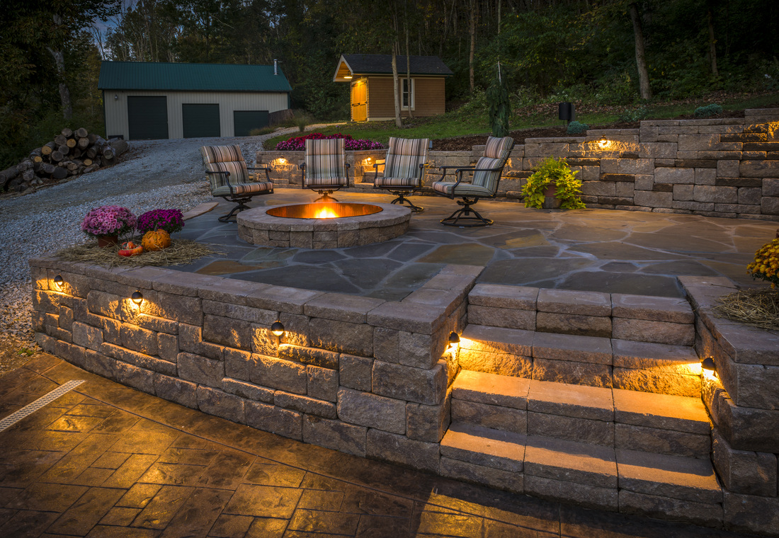 Lighted Stone Patio With Fire Ring